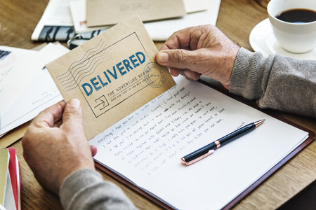 Man holding an envelope with delivered concept Imagens - 111438367