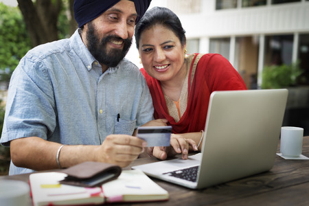 Indian Couple Using Device Concept Stock Photo