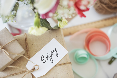 Gift boxes with Enjoy written on card