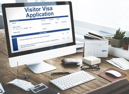 Desktop computer with visitor visa application form