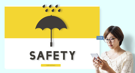 Woman using a smartphone with safety concept Standard-Bild - 111438593