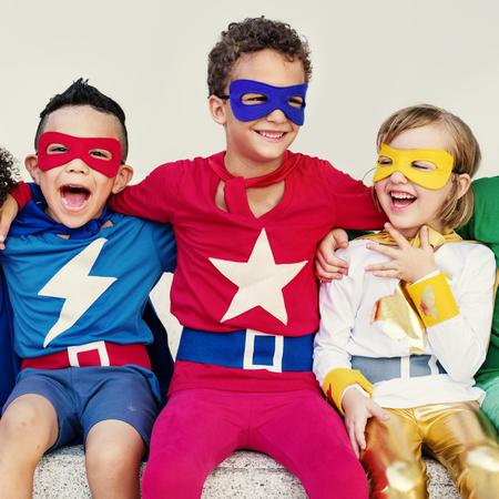 mixed race girl: Sitting Super Hero Kids Concept
