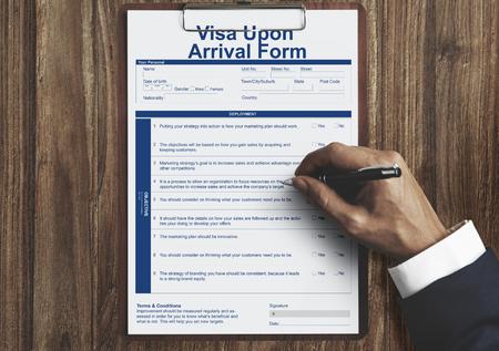 Businessman filling visa upon arrival form