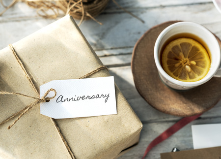 Gift box with anniversary written on card Stock Photo