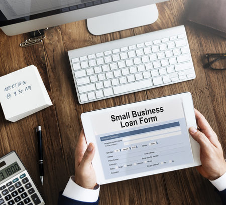 samll: Samll Business Loan Form Tax Credits Niche Concept Stock Photo