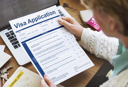 Woman holding visa application form Stock Photo