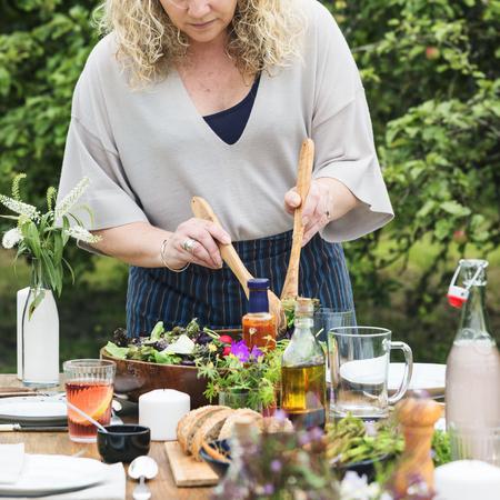 haciendo pan: Woman Preparing Table Dinner Concept