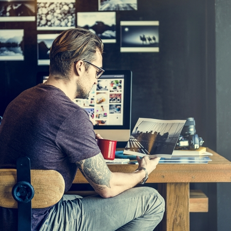 image editing: Man Busy Photographer Editing Home Office Concept