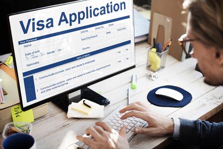 Businessman at work with visa application form