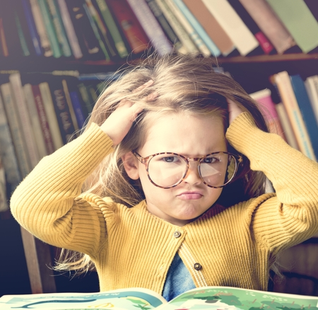 Adorable Cute Girl Stressed Out Reading Concept Stock Photo