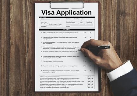 Man filling up a visa application