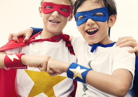 superheroes: Superheroes Friends Fist Bump Happiness Concept Stock Photo