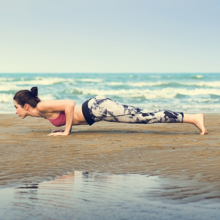 planking: Woman Planking Stretching Flex Training Healthy Lifestyle Beach Concept Stock Photo