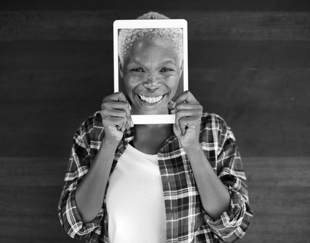 face covered: African Woman Digital Tablet Face Covered Smiling Technology Concept