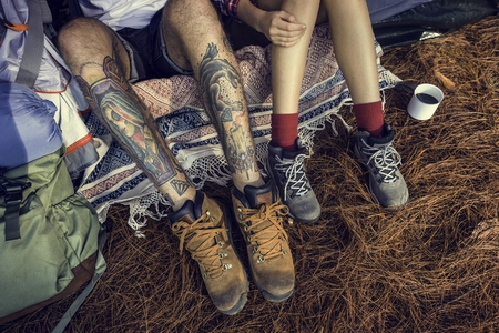 Couple Legs Relaxing Camping Outdoors Concept Фото со стока