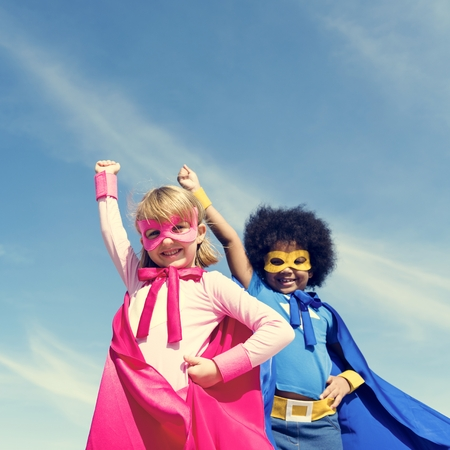 Children dresses as superheroes Stock Photo
