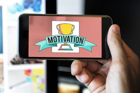 Motivation concept on mobile phone Standard-Bild