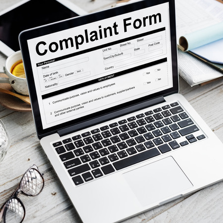 Complaint form concept on laptop screen