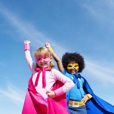 Children dresses as superheroes 版權商用圖片