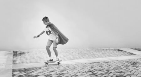 Superhero Boy Imagination Freedom Skateboard Concept Stock Photo