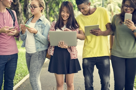digital device: Diverse People Walking Technology Campus Concept