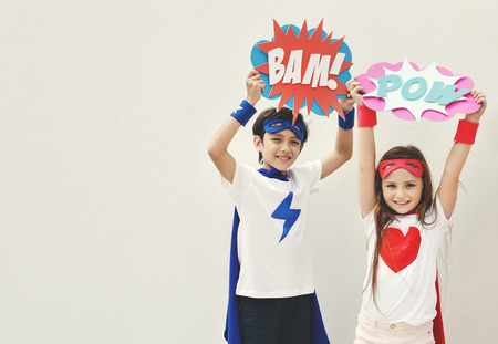 brother sister fight: Superheroes Kids Costume Bubble Comic Concept Stock Photo