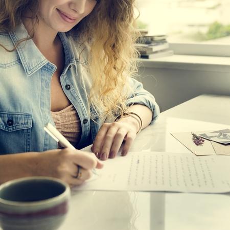 Woman writing report Imagens