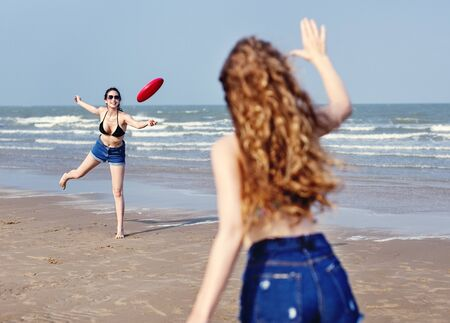 flying disc: Girls Beach Summer Holiday Vacation Togetherness Concept