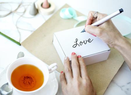 Writing love on gift box Reklamní fotografie - 111438664