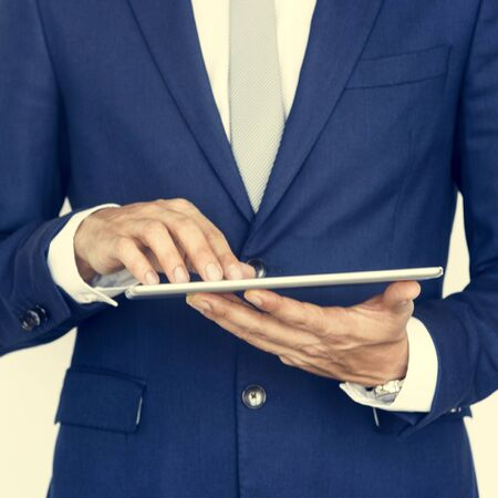 cropped: Cropped Business Guy Using Tablet Concept Stock Photo