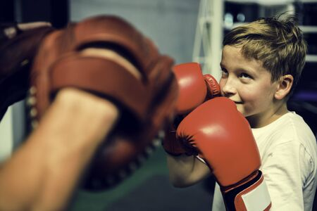 mitts: Boy Boxing Training Punch Mitts Exercise Concept Stock Photo