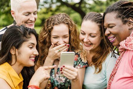 digital device: Women Using Digital Device Concept Stock Photo
