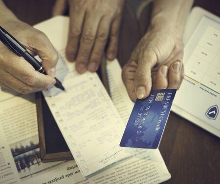 Senior Couple Paying Bill Concept Stock Photo