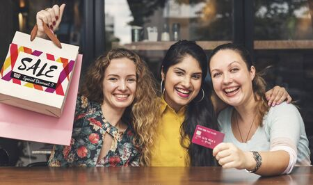 easy going: Young Women Shopping Credit Card Concept