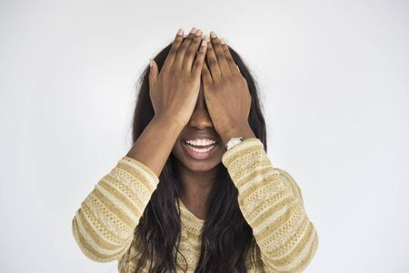 covering face: African Descent Hand Covering Face Concept