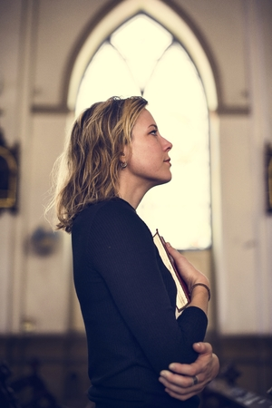 grieve: Woman Standing Church Religion Concept