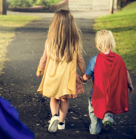 brother sister fight: Superheroes Kids Costume Imagination Learning Concept Stock Photo