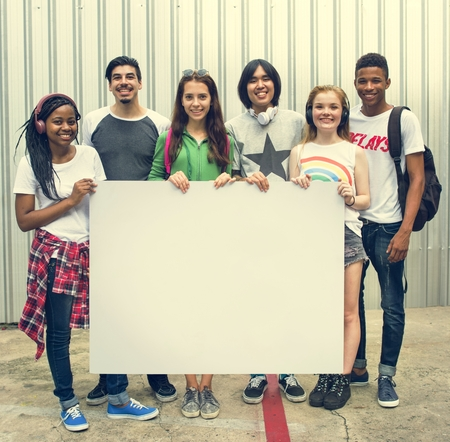 Diverse Group People Holding Blank Placard Concept Foto de archivo