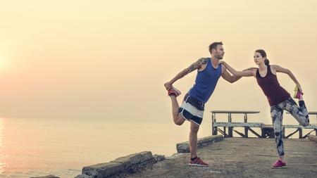 Stretching-Trainings Gesunder Lebensstil Strand-Konzept