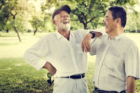 Senior Friends Retirement Talking Laughing Concept Stock Photo