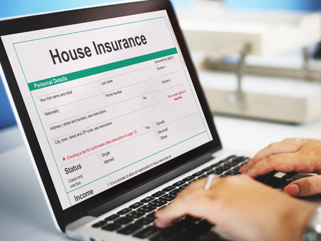 household insurance: House Insurance Document Form Concept Stock Photo