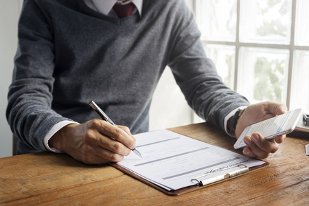 Man Writing Insurance Application Form Concept Stock Photo