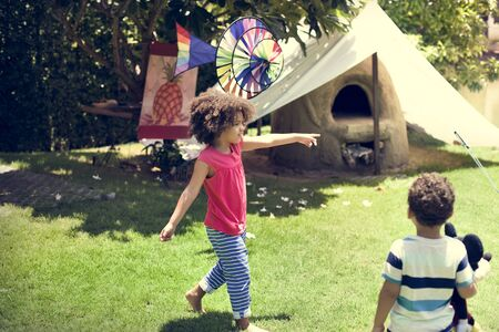siblings: Young Siblings Playing Outdoors Concept