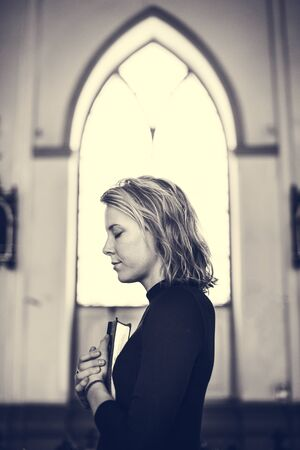 personal god: Woman Standing Church Religion Concept