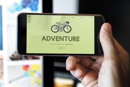 Mobile phone with adventure concept 版權商用圖片