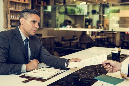 give out: Business Man Handing Out Report Restaurant Table Concept
