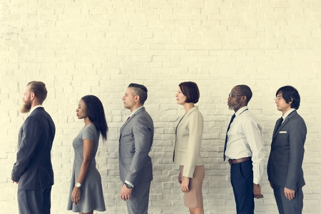 line up: Business People Line up Waiting Standing Concept Stock Photo
