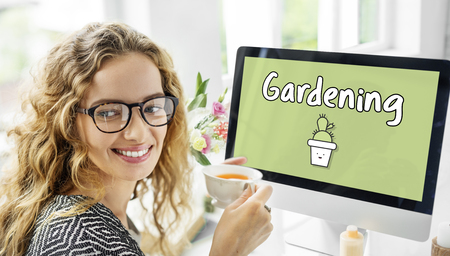 Monitor with gardening concept Imagens