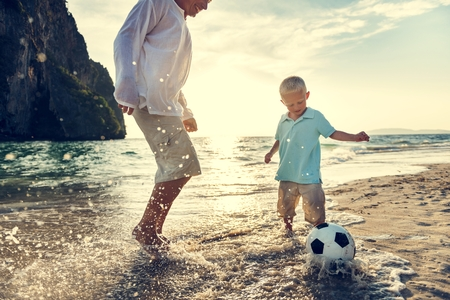 Football Beach Playing Leisure Activity Fun Concept Stock Photo