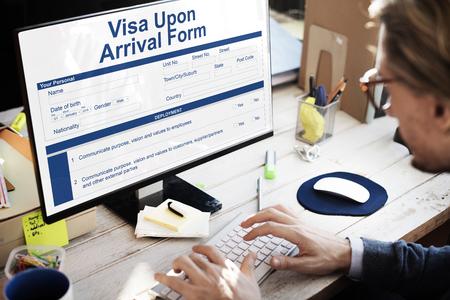 Man filling up a visa upon arrival form